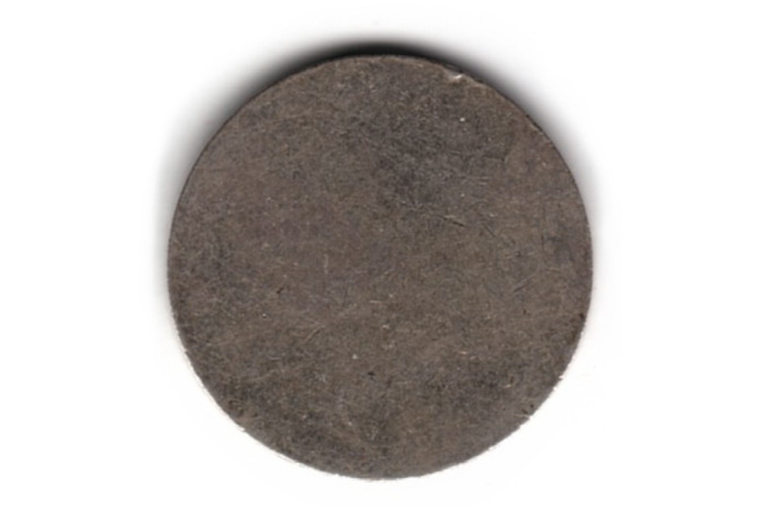 a coin blank for a United States nickel.