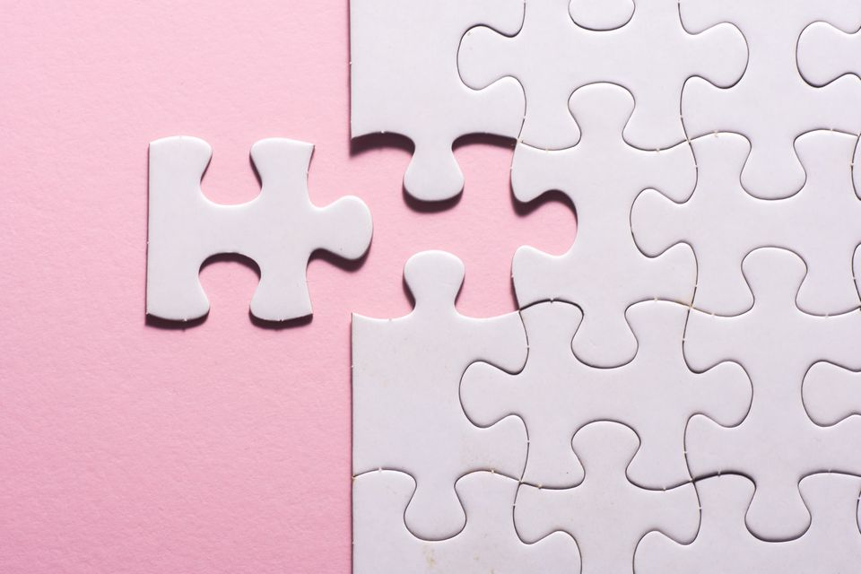 High Angle View Of Jigsaw Pieces On Table
