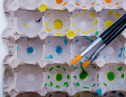 Paint brushes and egg carton