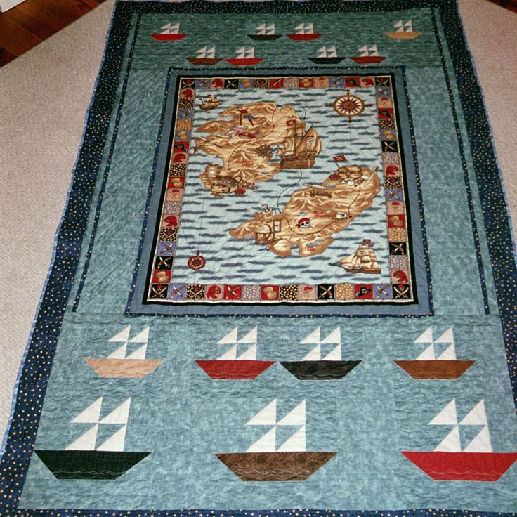 Pirate quilt with sailboats and map.