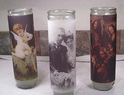 three prayer or devotional candles