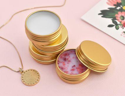 Three kinds of DIY lip balm in gold tins