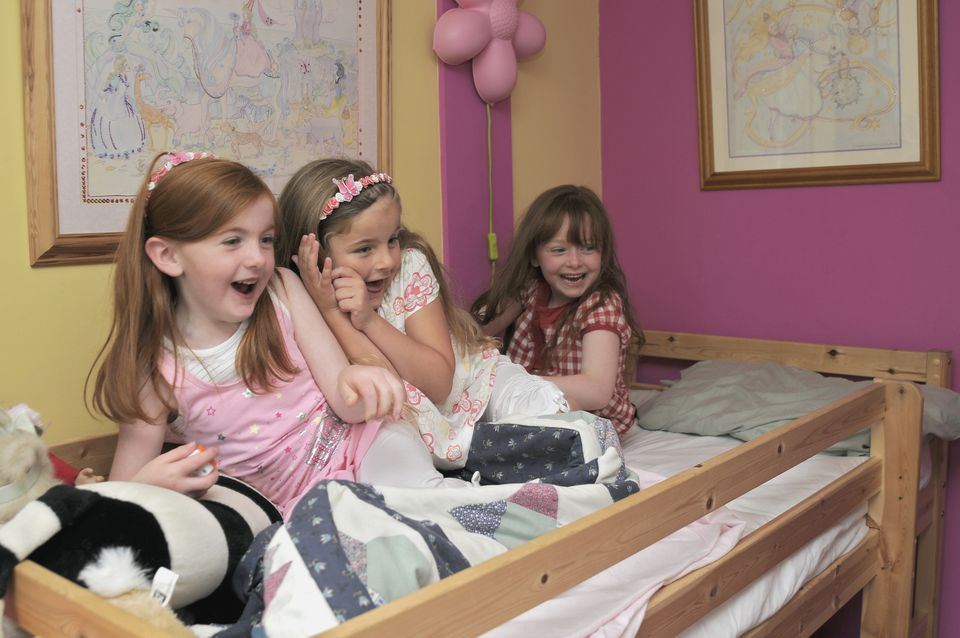 Girls playing on bunk beds