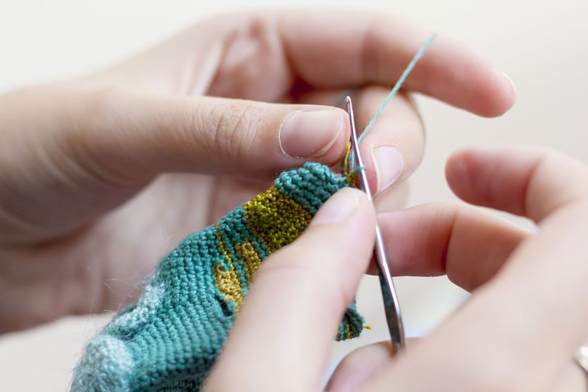 Close-Up Of Cropped Hand Crocheting
