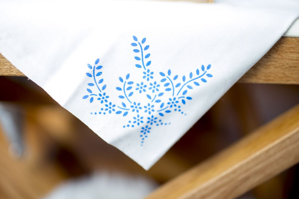 blue stencil on white fabric