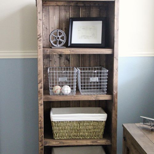 A four shelf rustic bookcase.