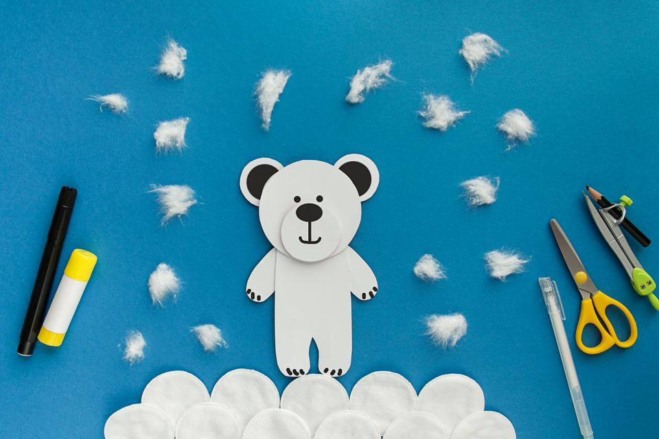 Easy Craft for kid. Winter greeting card Polar white Bear from paper and cotton disc. Children's art project. DIY concept.