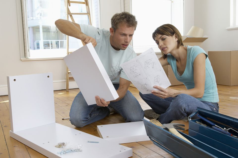 Couple constructing shelf