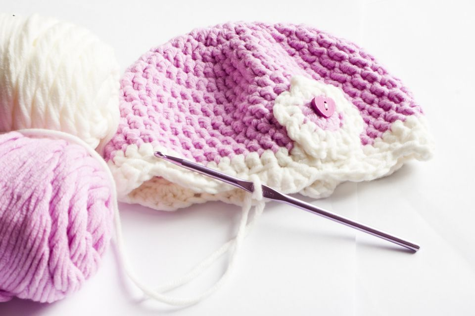 Yarn and pink baby hat