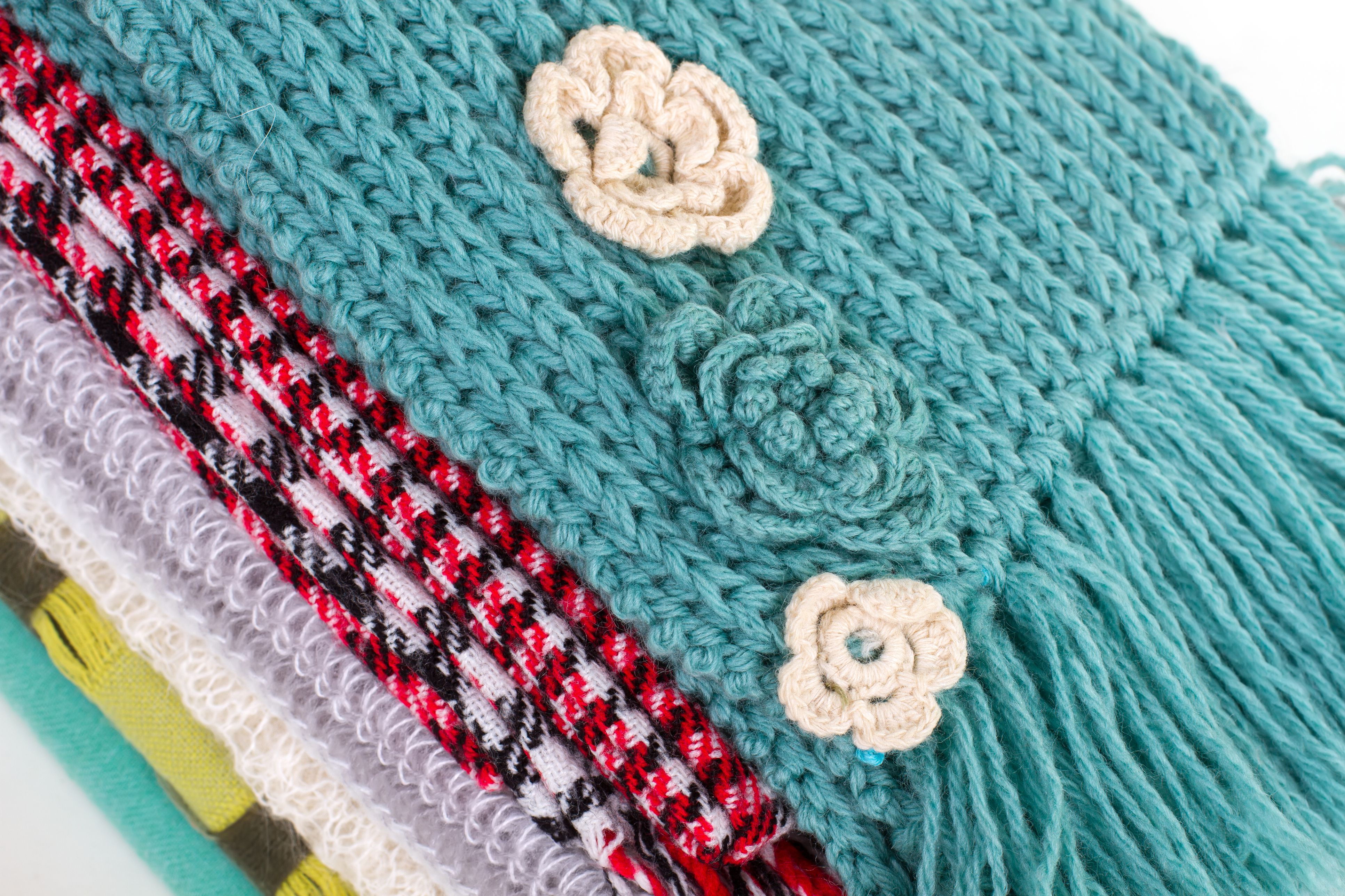 Beautiful crocheted flowers on the scarf.