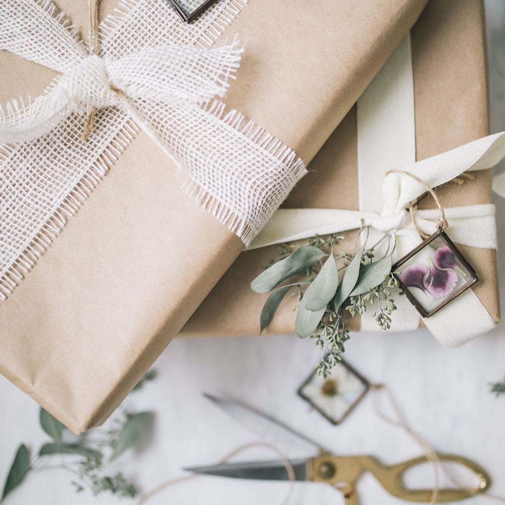 A stack of gifts with pressed flower tags
