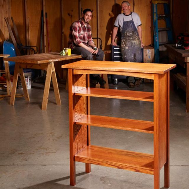 Two men building a bookcase.