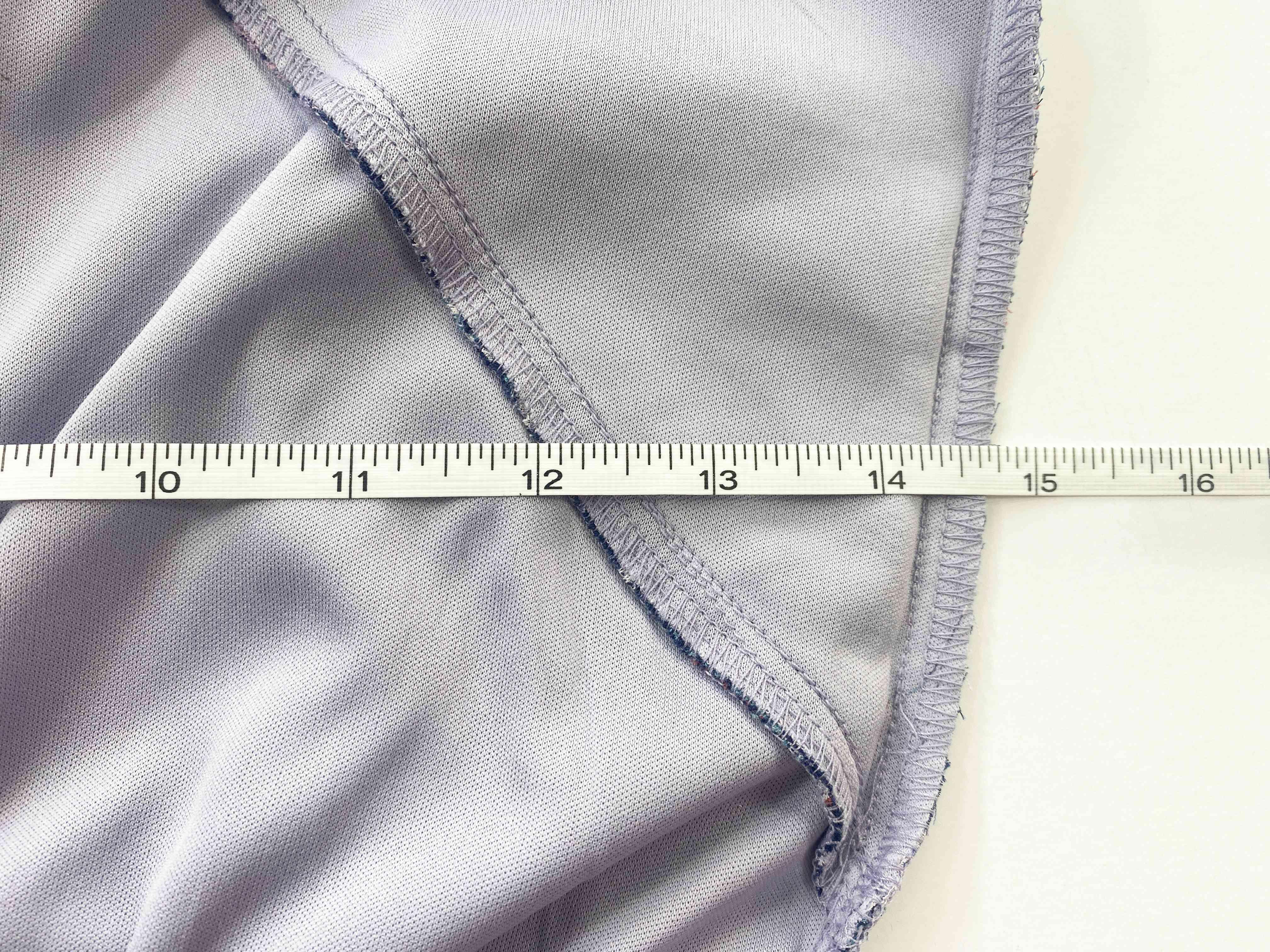 A tape measuring measuring a dress