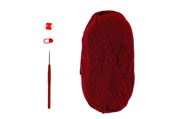 Knitting and crocheting flatlay.Burgundy yarn skein, crochet hook, row counter on white background isolated.Knit process