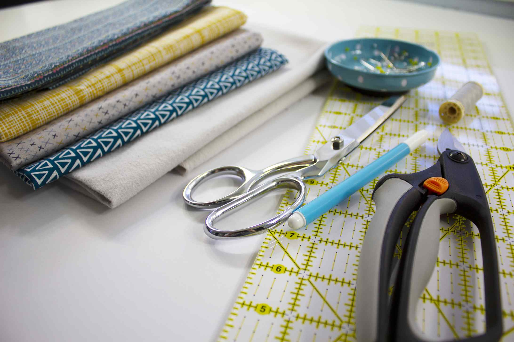 Fabric, pins, scissors, and other sewing notions