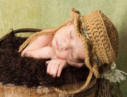 Baby wearing crochet hat