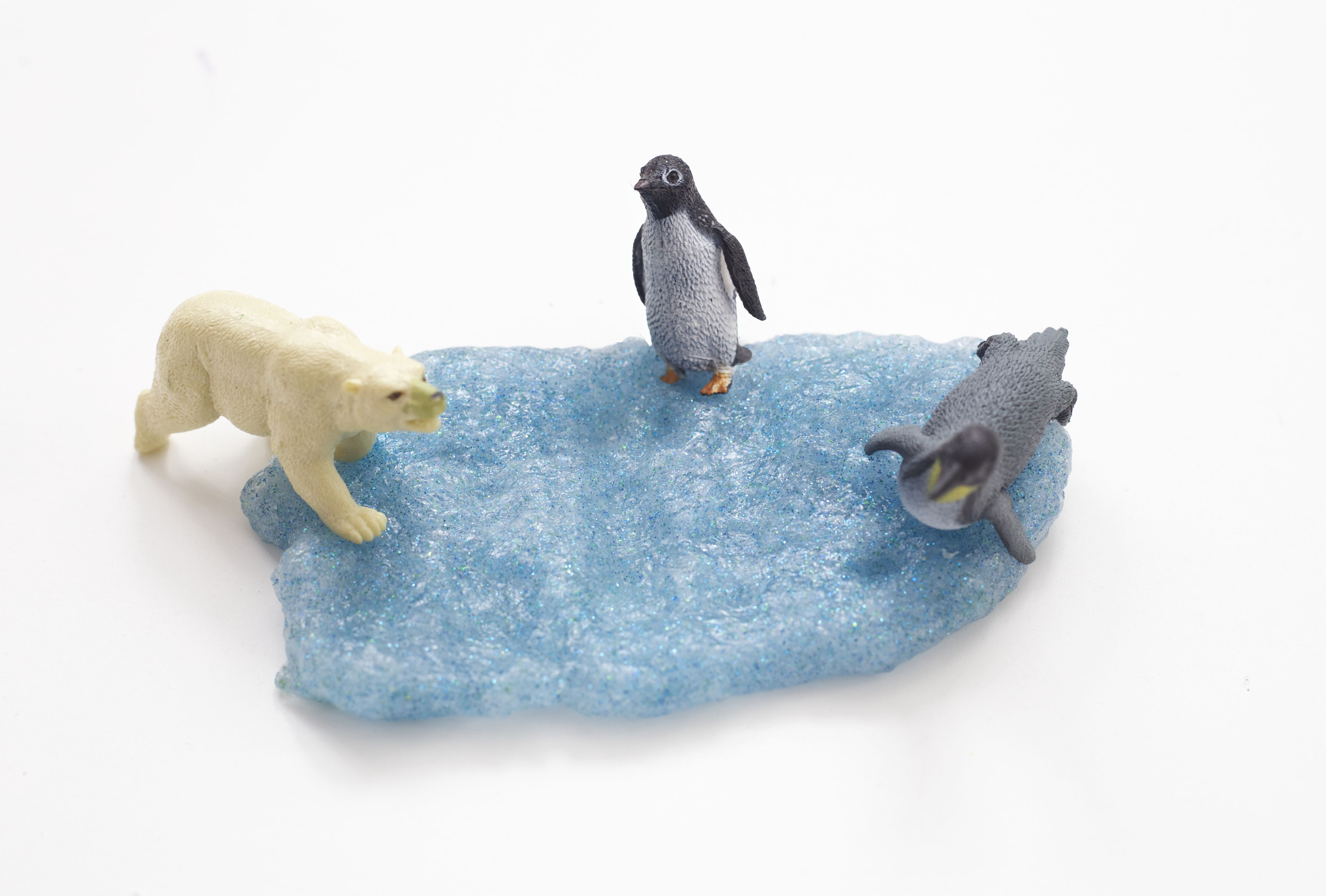 Light blue slime with plastic animals