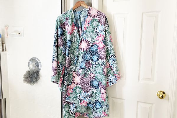 A colorful robe hanging in a bathroom