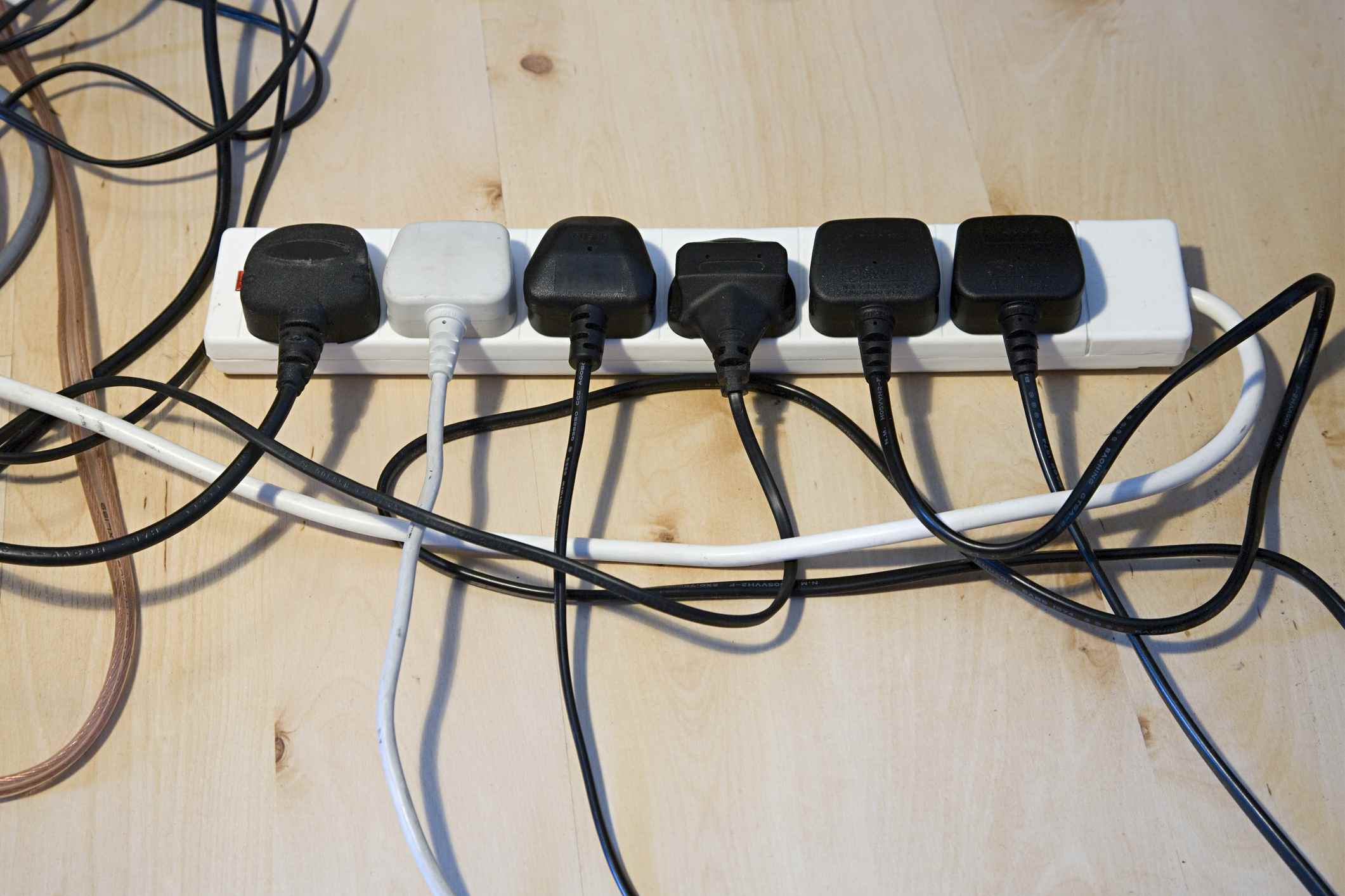 Extension cord that holds multiple plugs