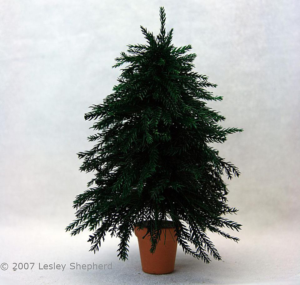 Six inch high miniature Christmas tree with realistic branches