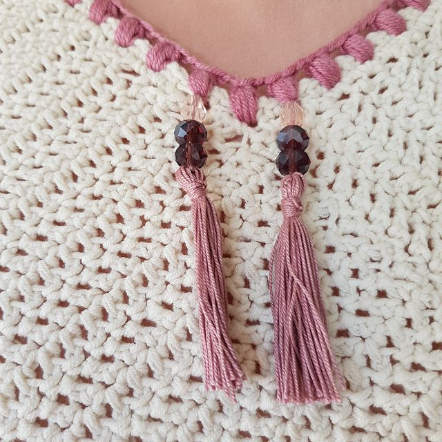 Crochet poncho with tassel detail
