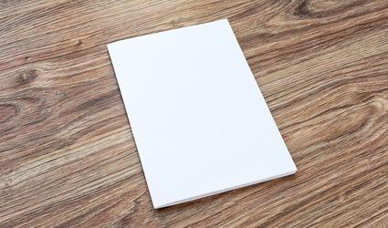 Blank of brochure is on a wooden desk.