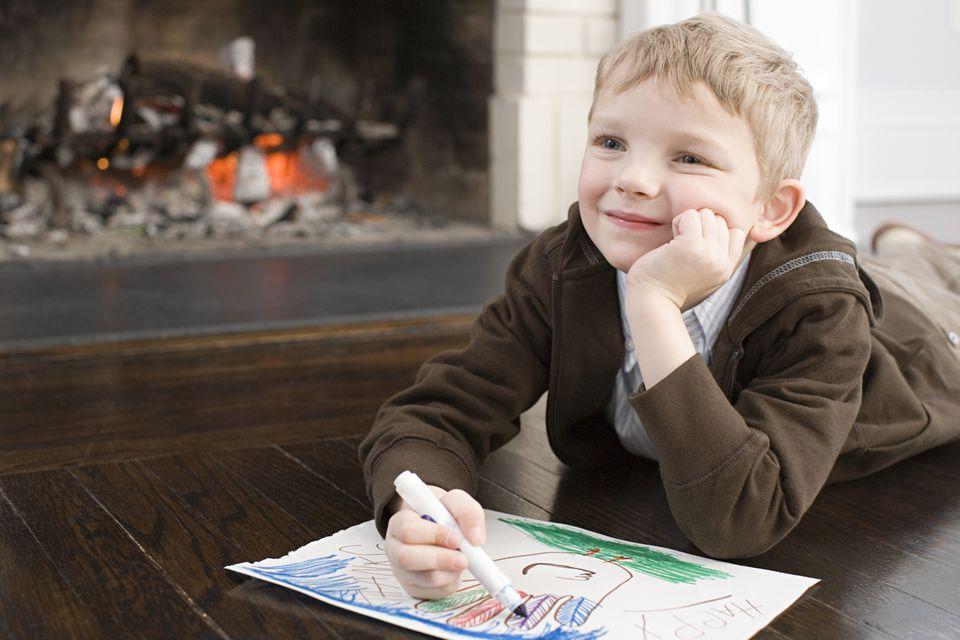 Boy coloring Thanksgiving turkey