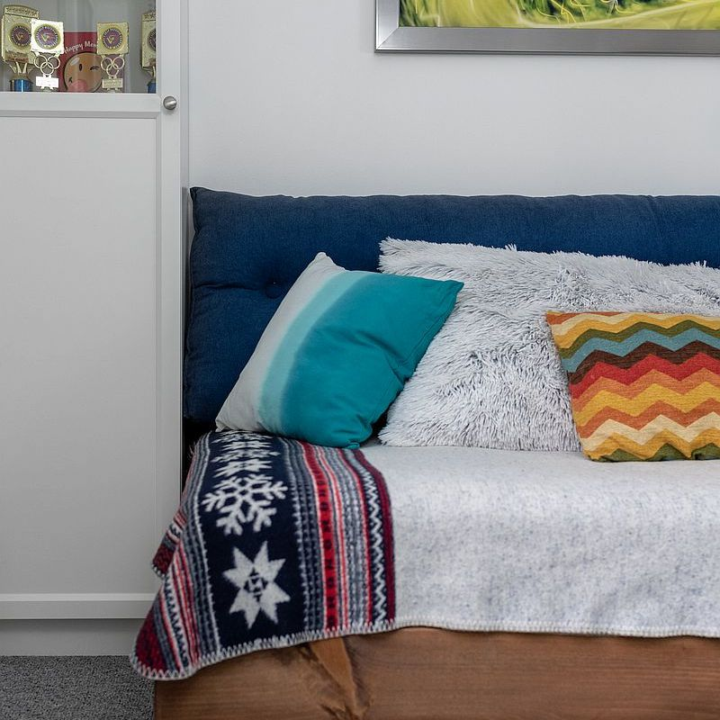 A platform daybed with colorful pillows