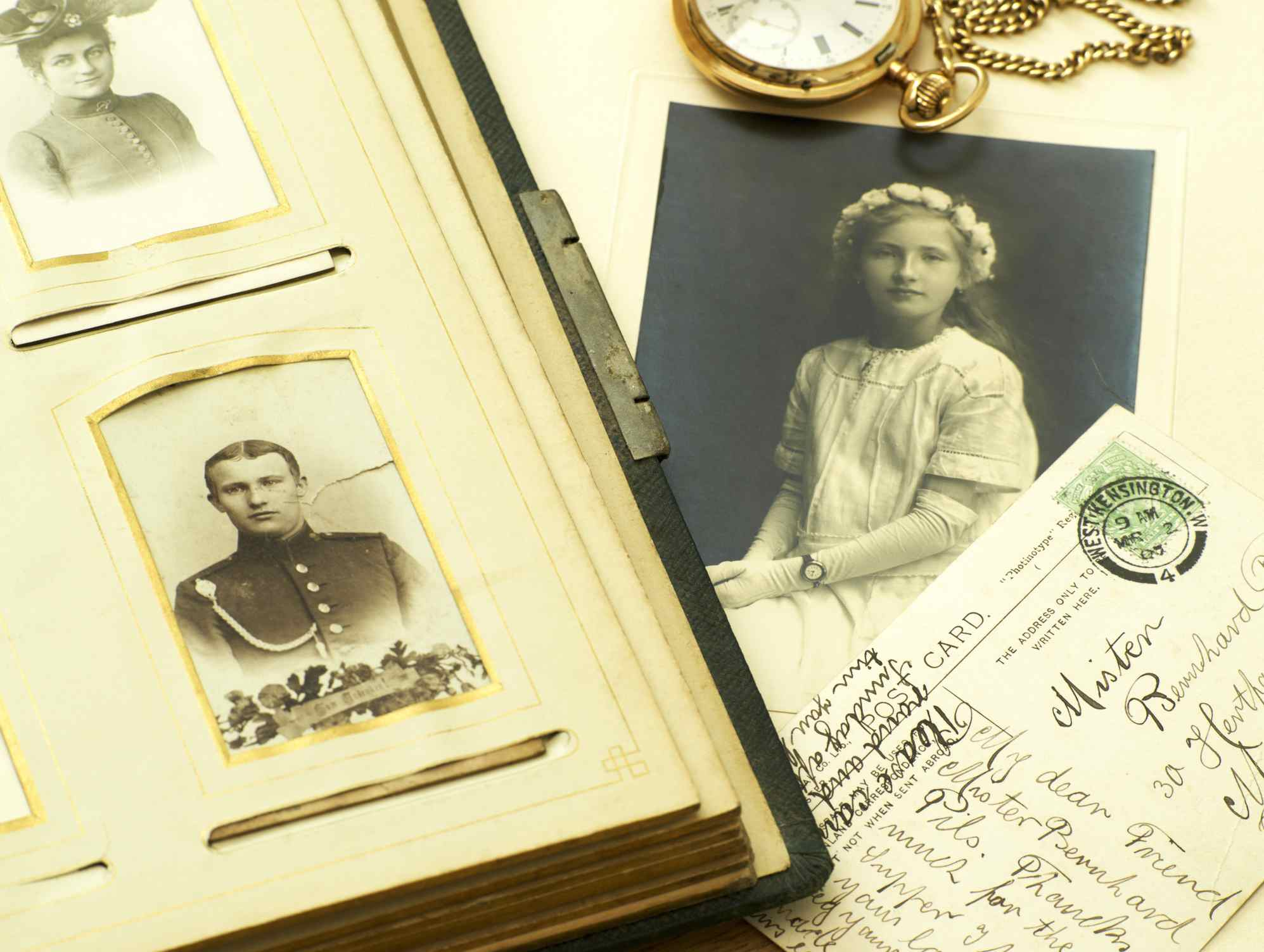Photographs with postcard and pocket watch