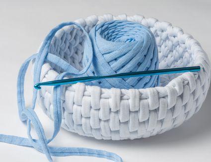 Crochet and knit fabric. Handmade baskets. Crochet thick threads. Knitting yarn