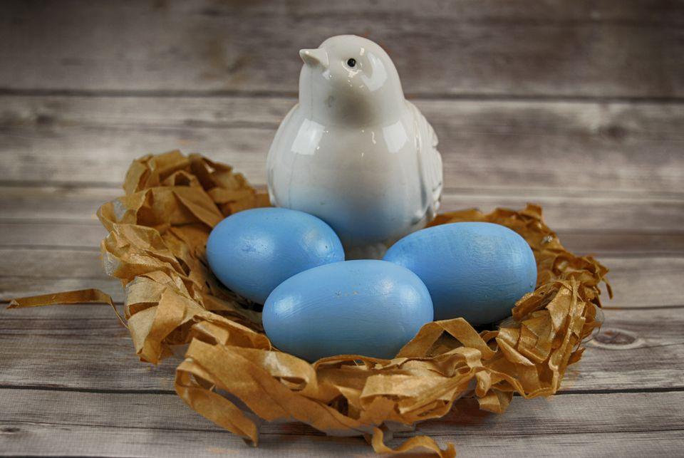 ceramic bird in a paper nest
