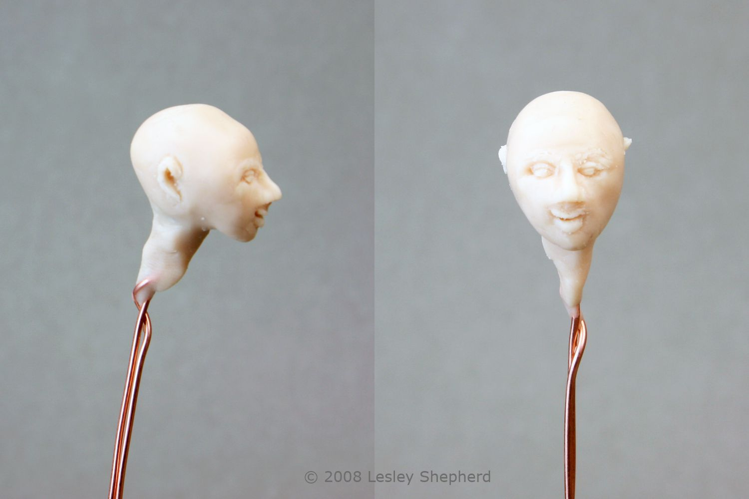 Adding a neck to and smoothing out the final features on a miniature doll head sculpture