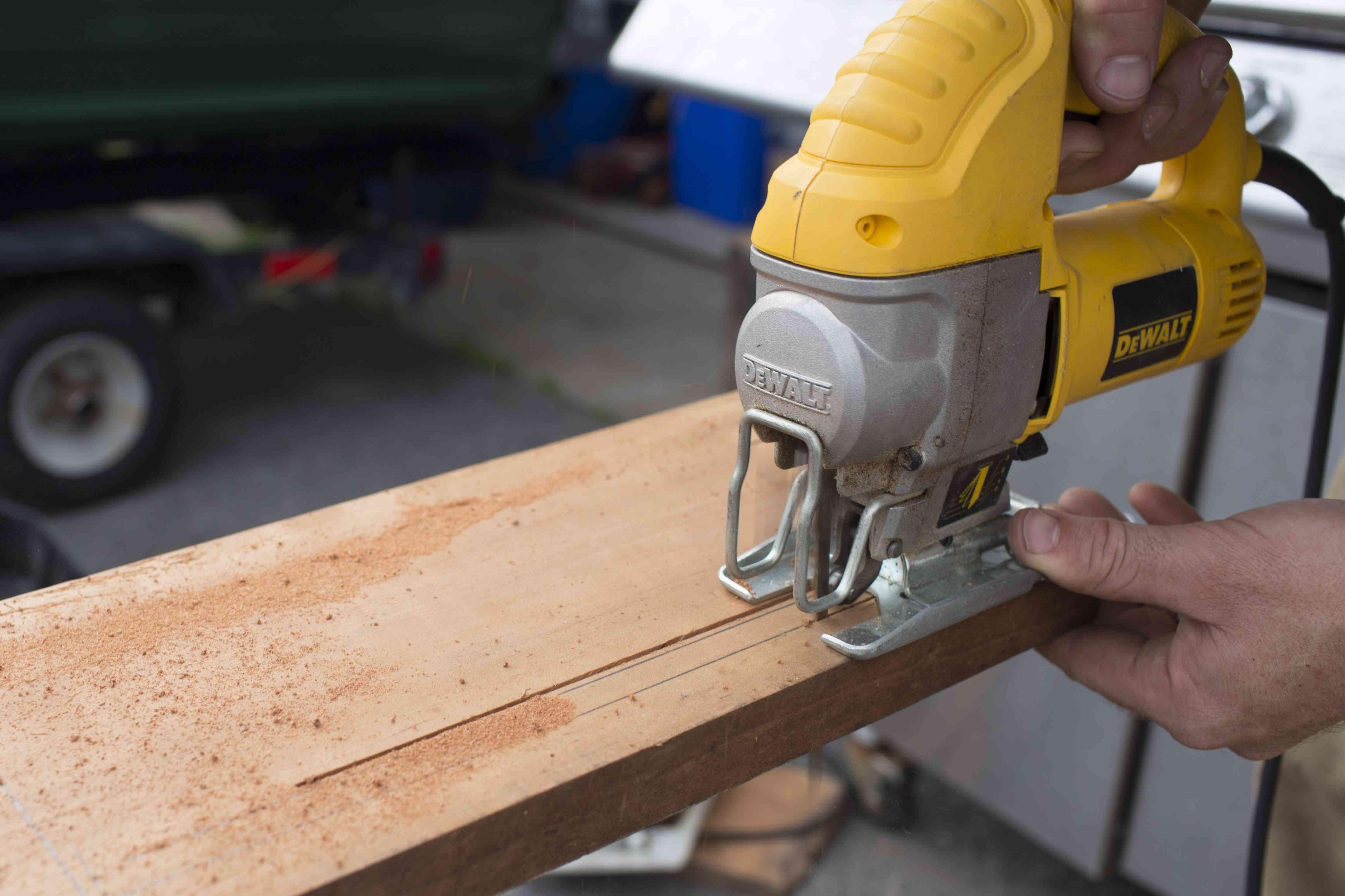 Cutting the wood legs.
