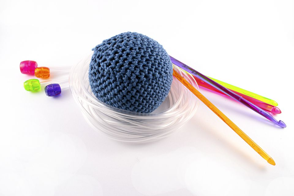 Tunisian crochet needles and crocheted ball