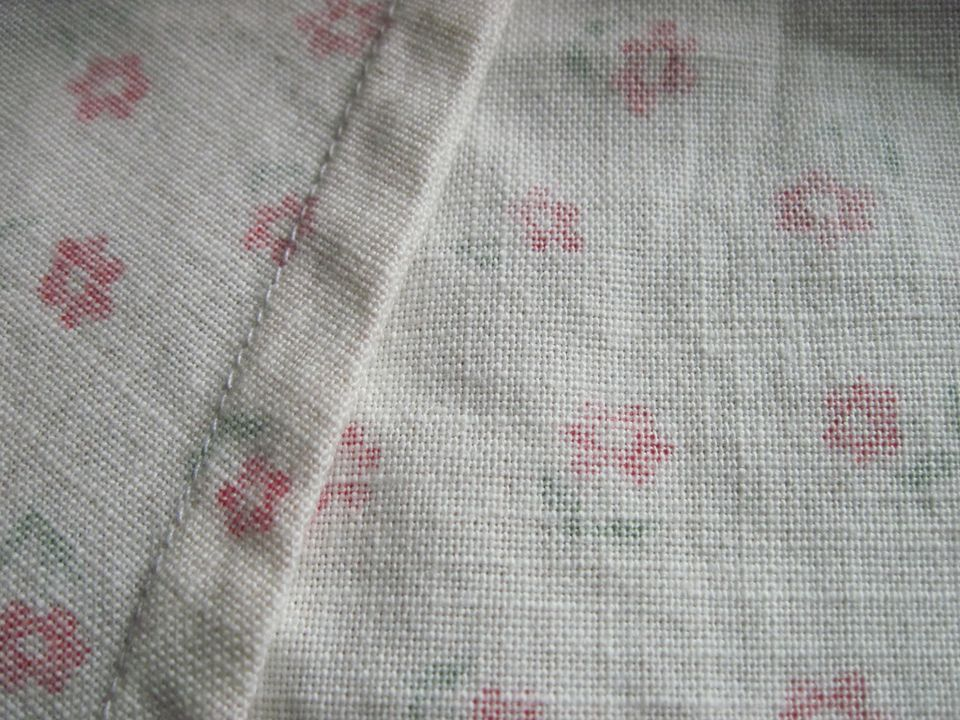 Close up of french seam on floral fabric.