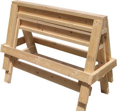 Sawhorses stacked on top of each other against white background