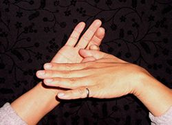 How to position your hands to pull apart your thumb