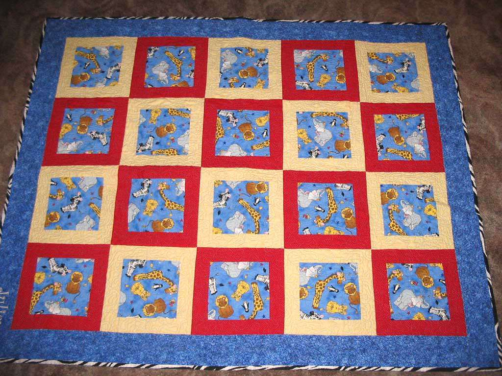 Blue baby quilt with zoo animals.