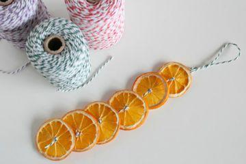 oranges strung on yarn