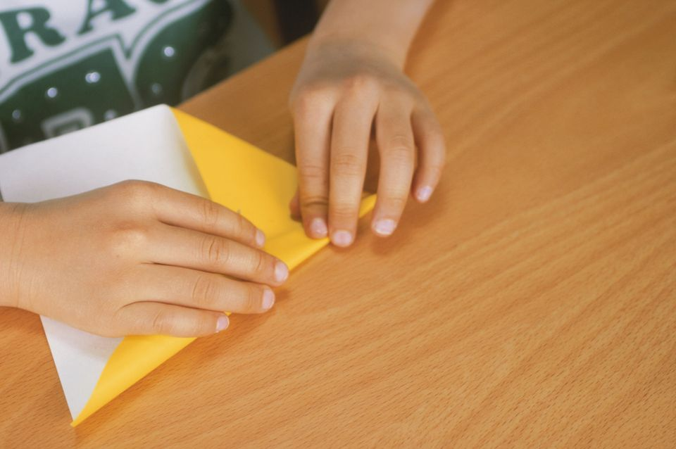 A child folding origami
