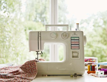 Sewing machine on table in front of window