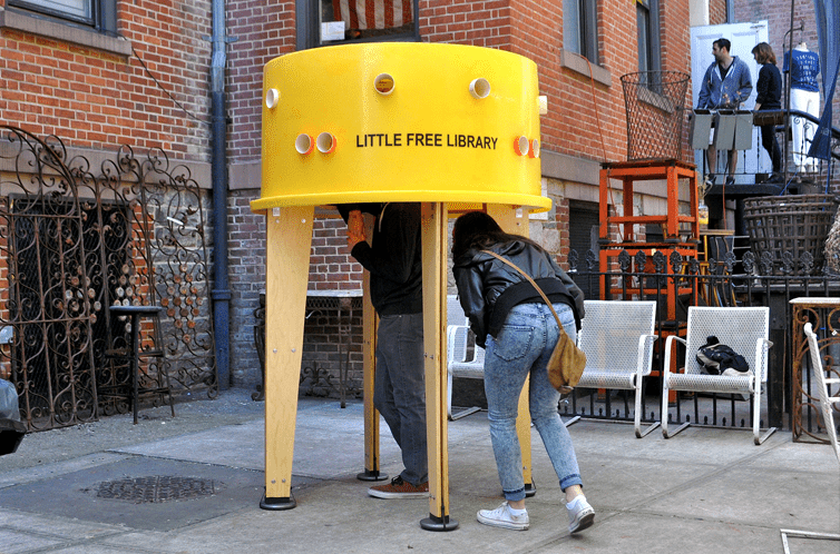 A yellow little free library