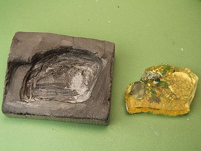 Cast section of E-Z Water for a dollhouse pond and the base made to hold it for a dollhouse garden.