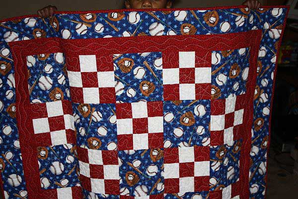 Red and blue baseball quilt.