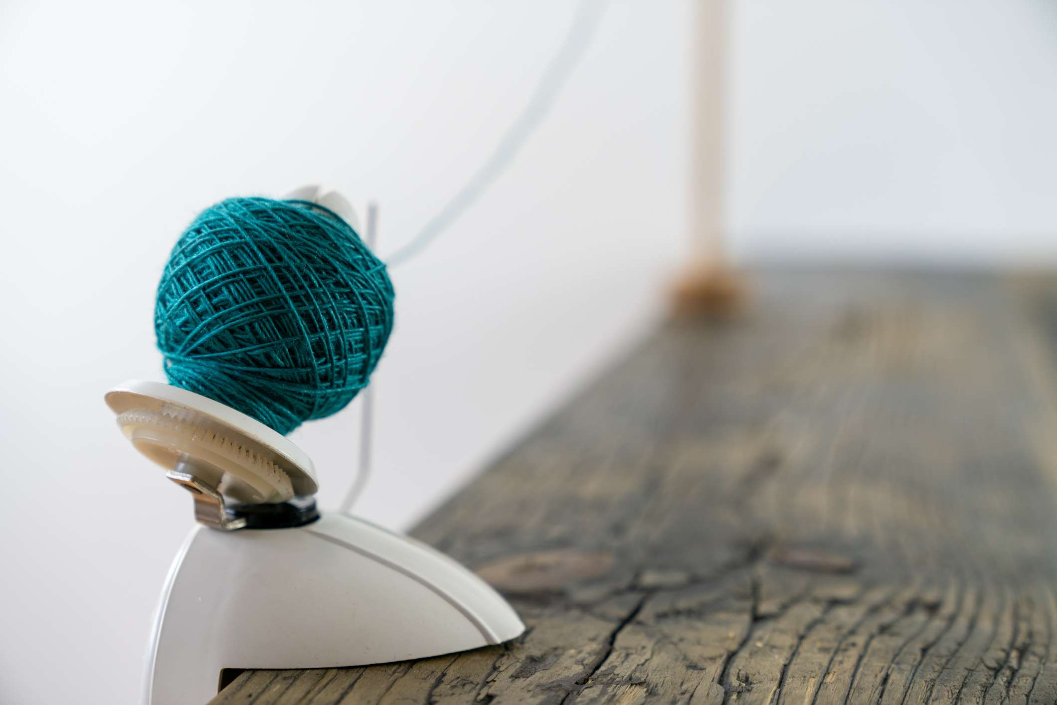 close up view of a hand-operated knitting roll or wool thread ball winder and knitting umbrellla