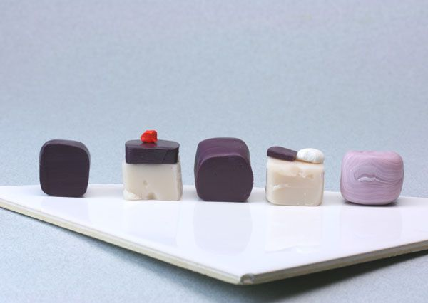 Colors of polymer clay used to make dolls house scale purple onions.