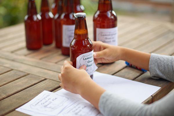 Woman making beer labels