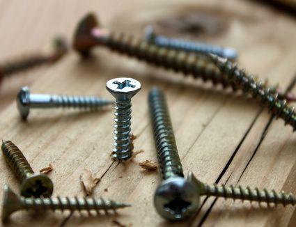 screws in a wooden board