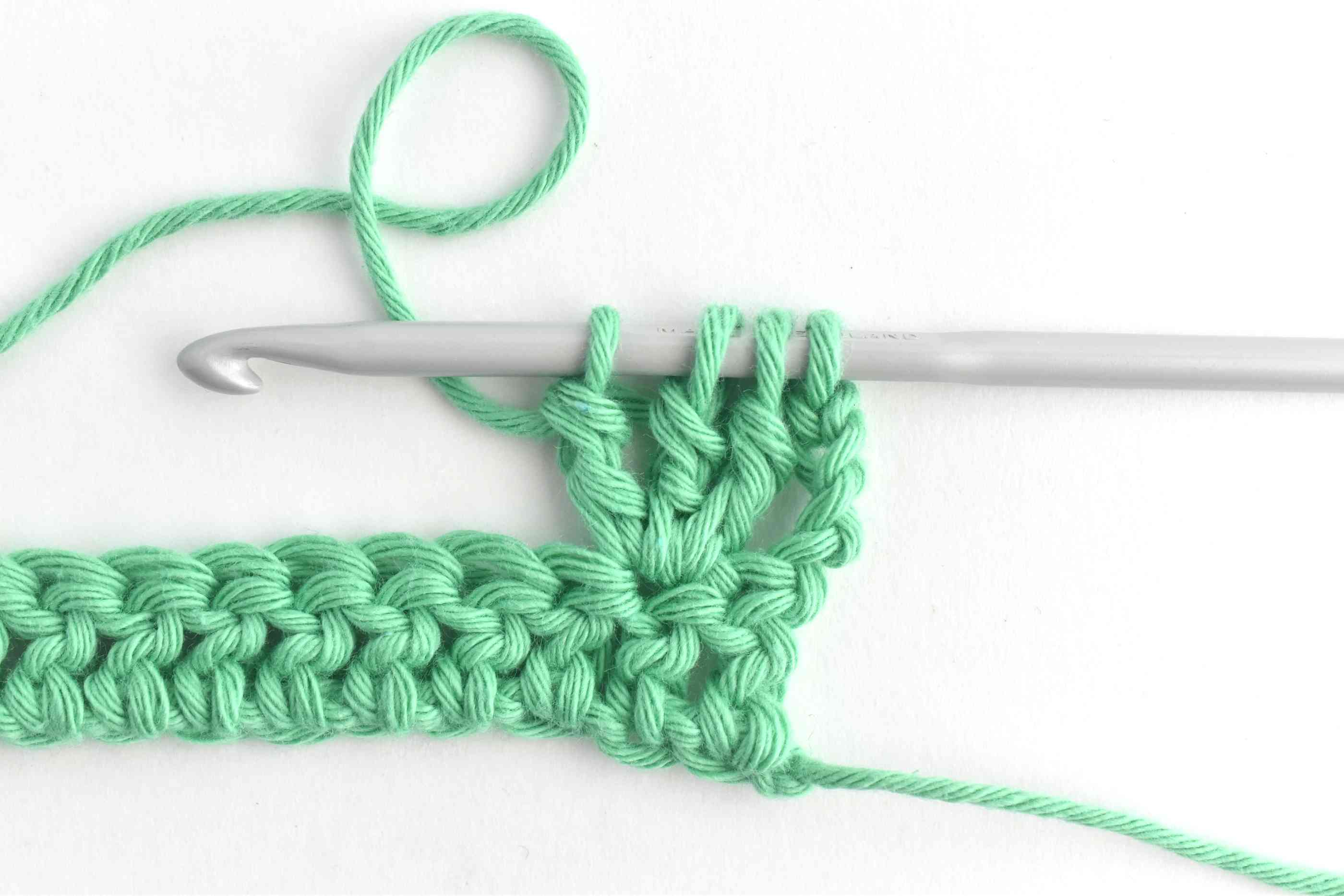 Make Two More Partial Treble Crochets (4 Loops on Hook)