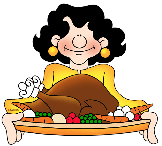 A woman holding a cooked Thanksgiving turkey